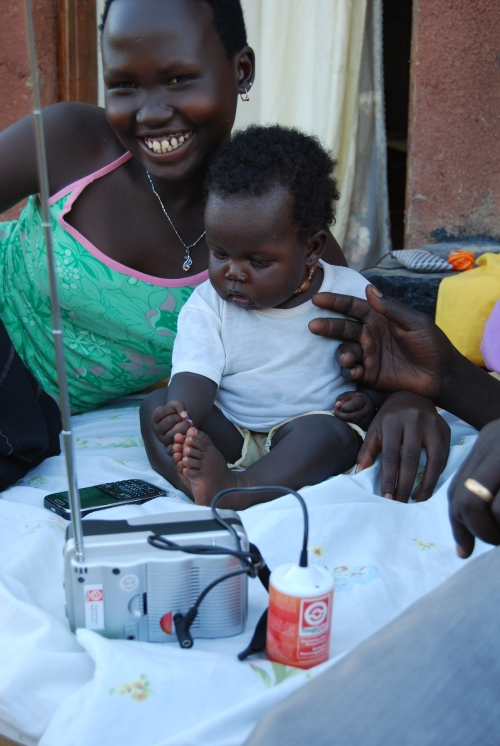 Woman and child with Sunlife radio South Sudan